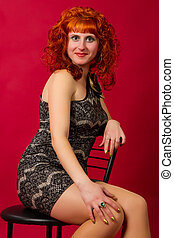 red-haired girl  in an elegant dress