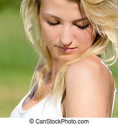 Beautiful young sensual woman closeup portrait