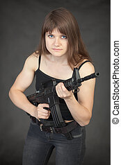 Beautiful young sexual woman - soldier with a rifle