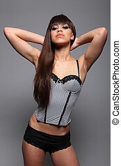 Beautiful young sexy woman in bustier lingerie