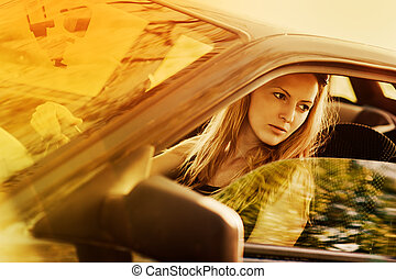 Beautiful young sexy woman in car