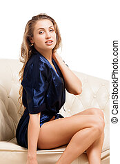 Beautiful young sexy woman sitting on chair