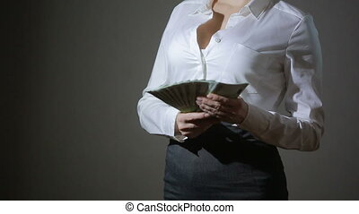 Beautiful young slim girl considers money