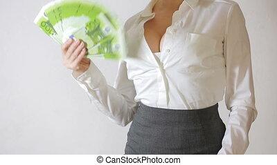Beautiful young slim girl considers money - sexy young girl...