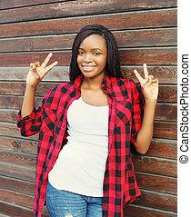 Beautiful young smiling african woman having fun in city