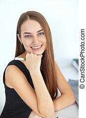 Beautiful young smiling business woman
