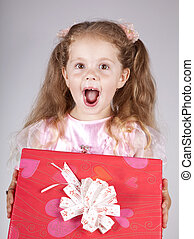 Beautiful young smiling girl with present box
