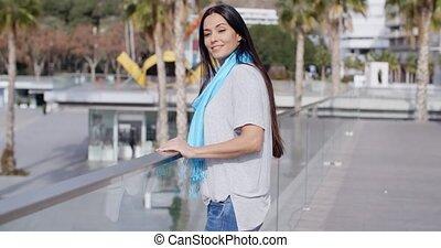 Beautiful young smiling woman at overlook - Single beautiful...