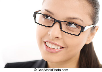 Beautiful young smiling woman in glasses, on white background. pretty girl with cute eyes looking away