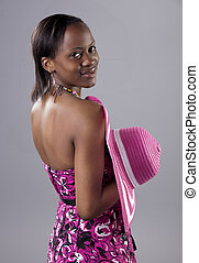 Beautiful young South African woman in bright colours looking back over her shoulder.