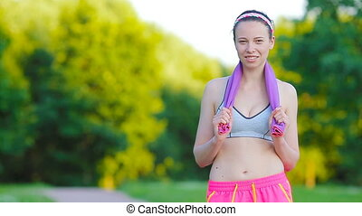 Beautiful young sport woman with towel. Portrait young...
