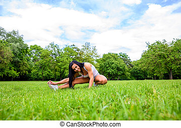 Beautiful young sporty girl in a park