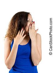 Beautiful young surprised woman looking at camera