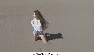 Beautiful young teen woman with blowing hair posing at...