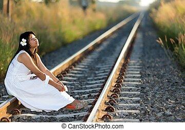 Beautiful young Thai woman meditating