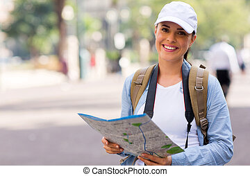young tourist holding a map