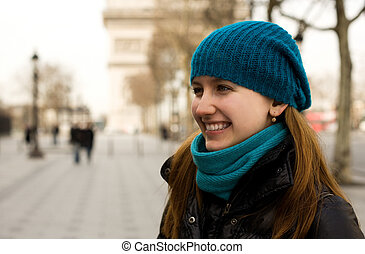Beautiful young tourist in Paris with the Triomphal Arch in the background