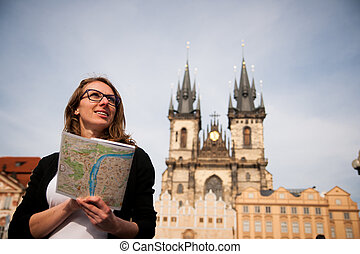 Beautiful young tourist woman photographing sites in Prague Czech republic, central europe