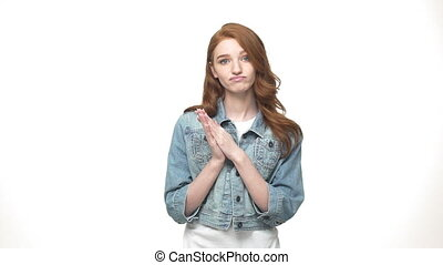 Beautiful young unhappy clap hands while standing isolated...