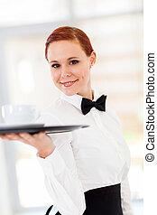 beautiful young waitress serving coffee