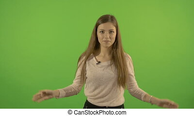 Beautiful young white model on a green screen background....