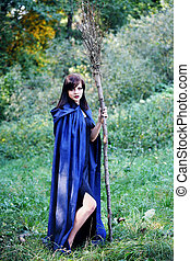 young witch with a broom