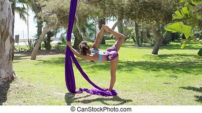 Beautiful young woman acrobatic dancer