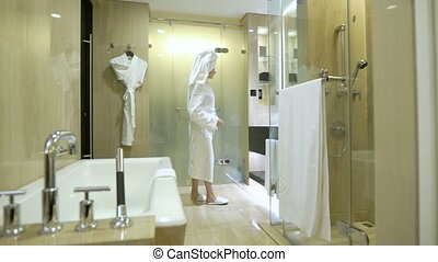 beautiful young woman after shower with a towel on her head...