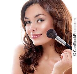 Beautiful Young Woman Applying Makeup