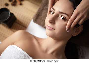 Beautiful young woman at a spa salon