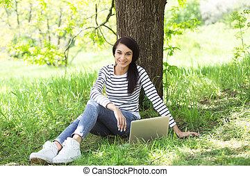 Beautiful young woman at garden