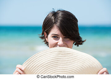 Beautiful young woman at the seaside