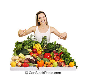 woman at the table with fruits and vegetables