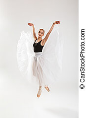 Beautiful young woman ballerina