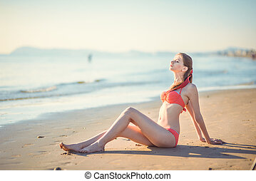 Beautiful young woman bikini pinup at beach