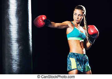 Beautiful Young Woman Boxing with Red Gloves
