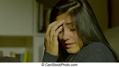 Beautiful young woman breathing deeply feeling emotion...
