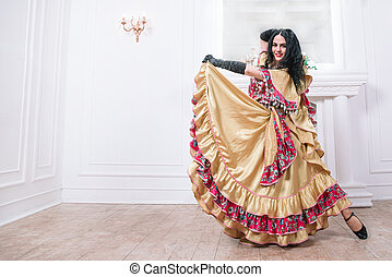 beautiful young woman dancer performing Gypsy dance