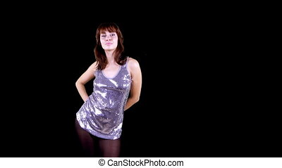 beautiful young woman dances and moves to the groove