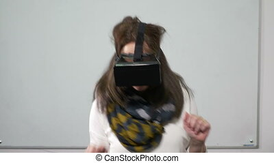 Beautiful young woman dancing with virtual reality glasses on