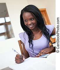 Beautiful young woman doing her homework