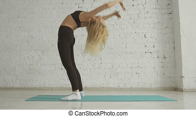 Beautiful Young Woman Doing Yoga Exercise, Stretching, Standing In Bridge Pose