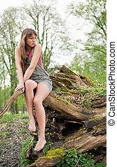 Beautiful young woman dreaming outdoors