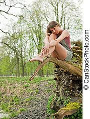 Beautiful young woman dreaming