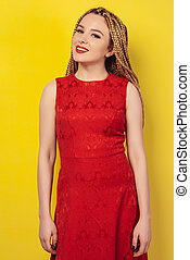 beautiful young woman dressed in a red dress.