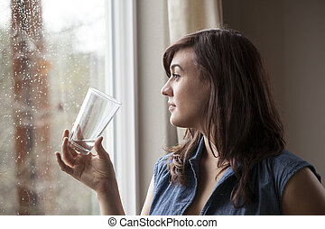 Beautiful Young Woman Drinking Glass of Water