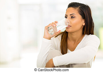 young woman drinking water - beautiful young woman drinking...