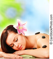 Beautiful young woman during spa treatment