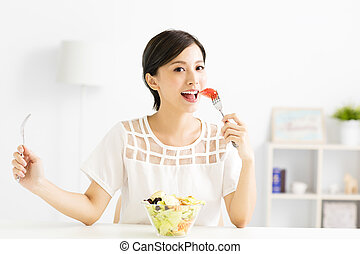 beautiful  young woman eating healthy food