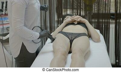 Beautiful young woman enjoying anti cellulite and anti fat...